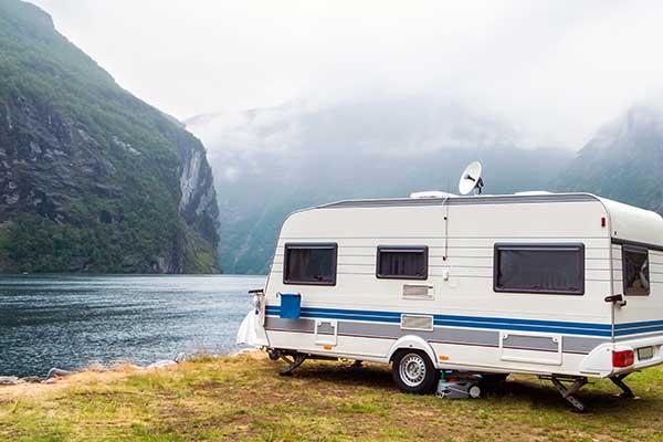 Caravan by lake